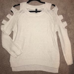 White sweater with cut sleeves